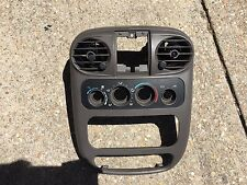 2001-2005 Chrysler PT Cruiser Dash Radio / Climate Control Bezel & Vents