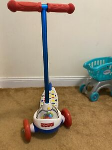 FISHER PRICE CORN POPPER SCOOTER-KIDS RIDE TOY-AGES 2+-