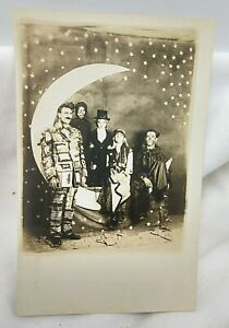 1900's Family in Halloween Costumes on Paper Moon RPPC