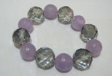 Lovely elasticated faceted beaded clear and lilac glass beads