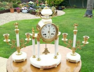 Impressive French Gilt and White Marble Portico Clock with Garnitures circa 1850