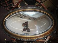 EDWARDIAN BEVEL EDGE OVAL MIRROR WITH BEADED AND BRONZED EFFECT WOODEN FRAME