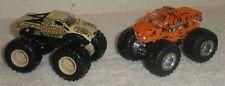 Lot 2 Hot Wheels Monster Jam 1:64 PROWLER Tiger vs POUNCER Cheetah w/ Metal Base