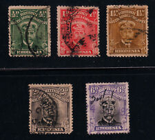 RHODESIA #119-#122, #127 Used Lot of 5 Stamps SCV $26.75