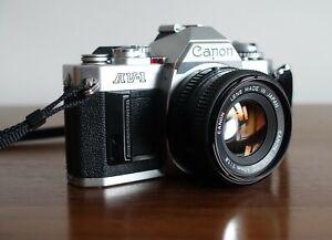 Canon AV-1 35mm SLR FILM CAMERA w/ Canon FD 50mm F/1.8 Lens +Hoya Filter +Manual
