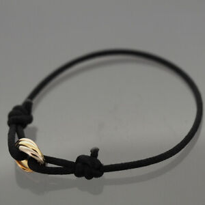 CARTIER 18K TRI COLOR GOLD BABY TRINITY BRACELET WITH BLACK CORD AND CERTIFICATE