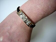Fashion Cast Glass Stones in a Curved Gold Tone Bar - Black Cord Bracelet