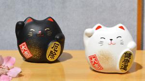 Two Maneki Neko Feng Shui Lucky cats black for protection white for health