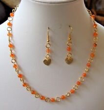 "Carnelian Bead Gold Plated 16"" Rosary Chain Necklace and 1"" Earrings."