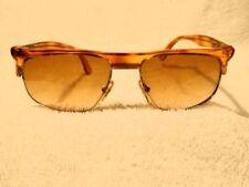 Lunettes de soleil vintage dorés