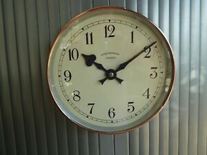 """Synchronome 12"""" slave clock in polished copper case"""