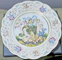 Grande piatto di Capodimonte in porcellana dipinta in rilievo Italia anno 1956