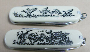 2 Sabre multi tool (4)  mallard ducks & fighting buck deer pocket knives