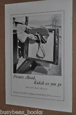 1925 Kodak advertisement, folding KODAK camera in automobile door pocket