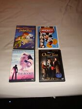 Walt Disney's The Rookie/Funny Factory Mickey/Peter Pan/Oliver Twist DVDS