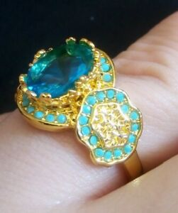 Oval Cut blue topaz ornate setting with insignias Ring 18K Yellow Gold Filled