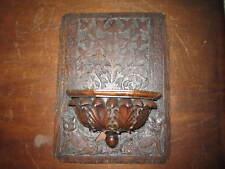 Un panel de madera labrada Curioso Viejo