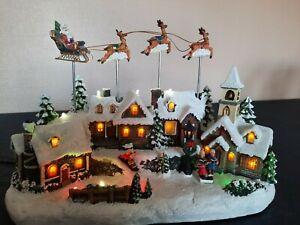 Village de Noël lumineux, musical et animé