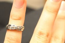 9ct white gold cross band round brilliant diamond and blue topaz channel ring