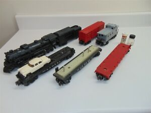 Lionel Lot-Locomotive and Tender, boxcar, several flat cars, caboose-O ga-Fair.