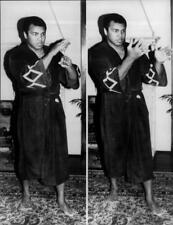 American boxer Muhammad Ali shows up his magic tricks in his new show. - Vintage