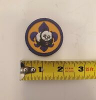 "BOY CUB SCOUT NEW ""WORLD CONSERVATION "" PATCH - OFFICIAL BSA - Panda purple tan"