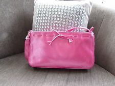 Oasis Pink Patent Bag with Stitched Bow detail Removable Strap.