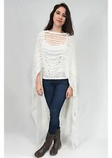 Cable knitted multi-use piece can be worn as a scarf, poncho, shawl, vest top