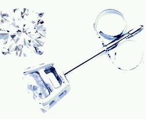 Orecchini Punto Luce in oro 18 Kt e diamanti naturali 0,14 ct Regalo Cresima