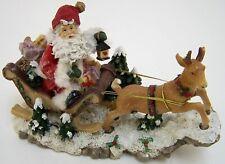 Weihnachtsmann mit Renntier & Schlitten Dekofigur Kunstharz Maße 24 x 10 x 15 cm