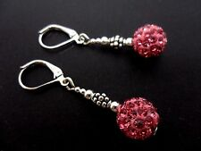 A PAIR OF DANGLY PINK SHAMBALLA STYLE LEVERBACK HOOK EARRINGS.