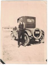 Snapshot of Young Man Next to a Ford Model T around 1910