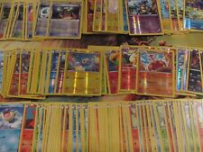 Pokemon tcg lot of 200 NEW CARDS, 10 code cards, 1 player's guide