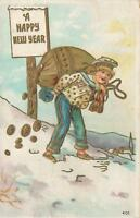 1908 BOY in SNOW with BAG of GOLD GILT COINS HAPPY NEW YEAR EMBOSSED POSTCARD