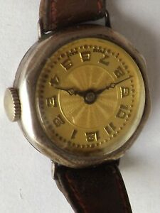 a vintage ladies hallmarked silver cased yellow patterned dial watch