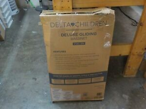 Delta Children Smooth Glide Bedside Bassinet - Portable Crib with Activity Mobil