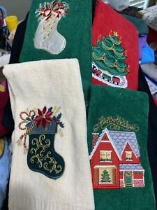 set of 4 Christmas tea towels - new without tags