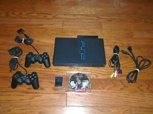 FULLY TESTED Playstation 2 console with Network Adapter & Resident Evil Game PS2