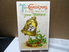 1910 Embossed Postcard Christmas Gold Bell & Holly John Winsch Card