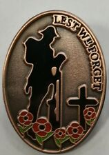 LEST WE FORGET POPPY LAPEL BADGE BRISTISH ARMY