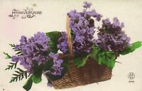 1924 VINTAGE FRANCE HAPPY ANNIVERSARY BASKET of PURPLE FLOWERS POSTCARD