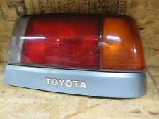 TOYOTA TERCEL 91-94 1991-1994 TAIL LIGHT PASSENGER RH RIGHT w/ GREEN TRIM OEM