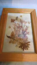 bouquet de fleurs sechees sous verre