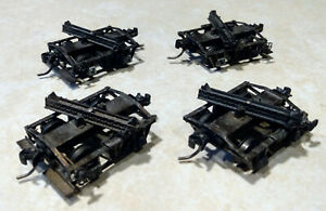 Kadee HO scale logging disconnect cars, 2 sets of two cars.