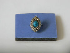 LARGE TURQUOISE COLORED ADJUSTABLE RING FROM ESTATE SALE