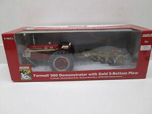FARMALL DEMO 560, WITH GOLD DEMO PLOW, NIB