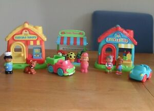 Elc Happyland Bakers, toy shop, petula`s flowers ,4 figures, 2 cars, a dog,