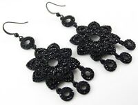 BLACK SWAROVSKI CRYSTAL EARRINGS WITH LONG BLACK FLOWER AND DISC CHARMS BY ZEST.
