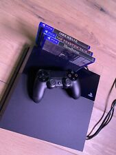 Sony PlayStation 4 with 3 games