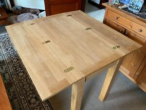 Solid wood folding kitchen table natural finish